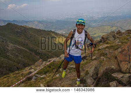 ALMATY, AUGUST 20: Skyrunner runs in the mountains on August 20, 2016, Alamty (Kazakhstan)