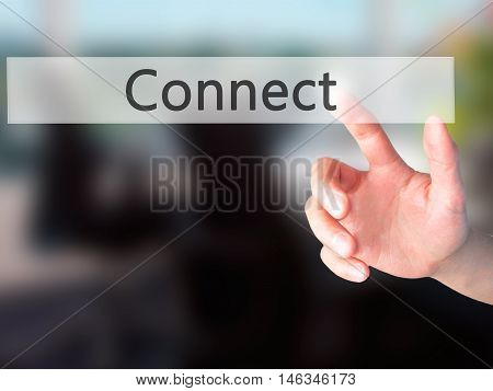 Connect - Hand Pressing A Button On Blurred Background Concept On Visual Screen.