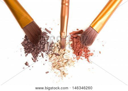 Makeup brushes set and loose powder eyeshadows isolated on white background, visage and cosmetic tools macro shot