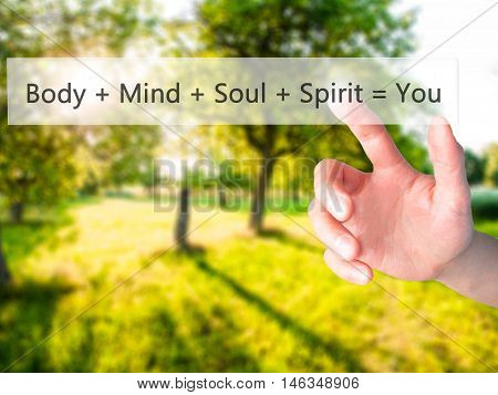 Body + Mind + Soul + Spirit = You - Hand Pressing A Button On Blurred Background Concept On Visual S