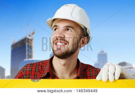 Builder checking spirit level . Mixed media