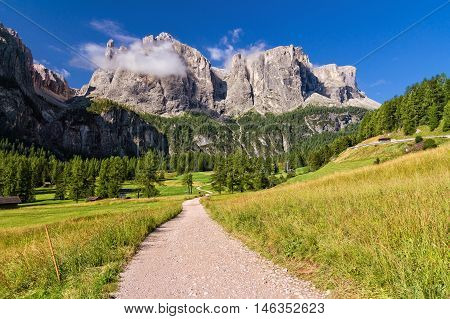 footpath in high Badia Valley on background Sella mount Alto Adige Italy