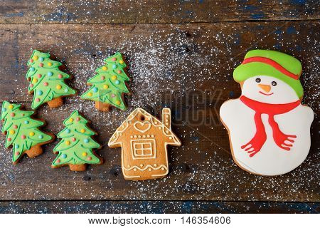 Christmas Cookies In The Shape Of Snowman, New Year Tree And House