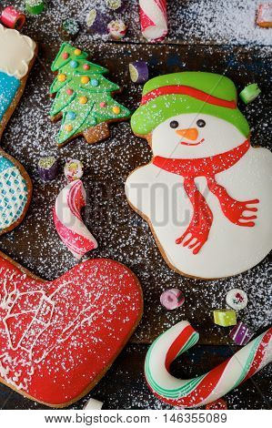 Christmas Ginger Cookies And Sweet Candy Strewn With Snow