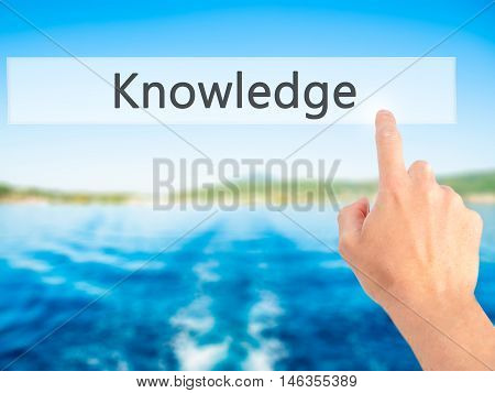 Knowledge - Hand Pressing A Button On Blurred Background Concept On Visual Screen.