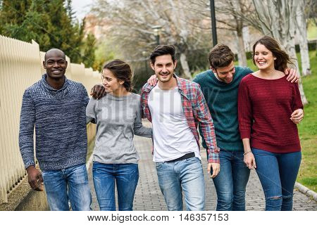 Group Of Friends Having Fun Together Outdoors