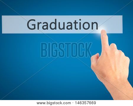 Graduation - Hand Pressing A Button On Blurred Background Concept On Visual Screen.