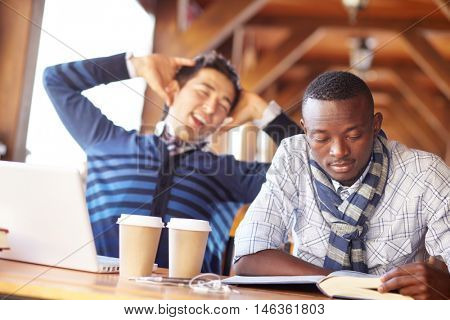 Two students having break in cafe