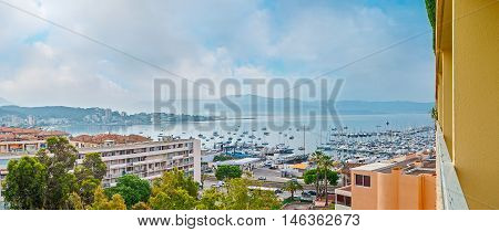 The coastal neighborhood with the view on large port with fishing boats and yachts and the living houses of Ajaccio Corsica France.