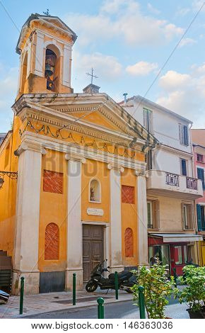 The bright yellow building of the Church of St John the Baptist with the small belfry located in the old town of Ajaccio Corsica France.