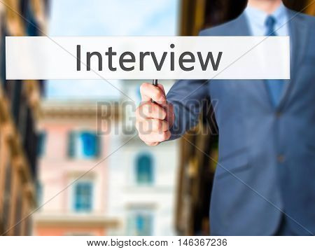 Interview - Businessman Hand Holding Sign