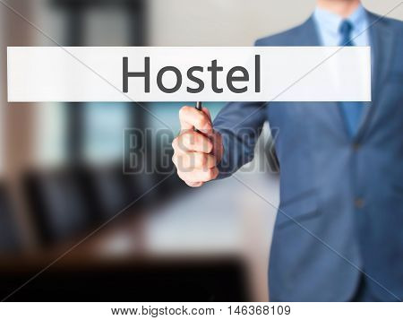 Hostel - Businessman Hand Holding Sign