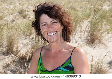 Portrait Of Lovely 40-year-old Brunette Woman At Beach