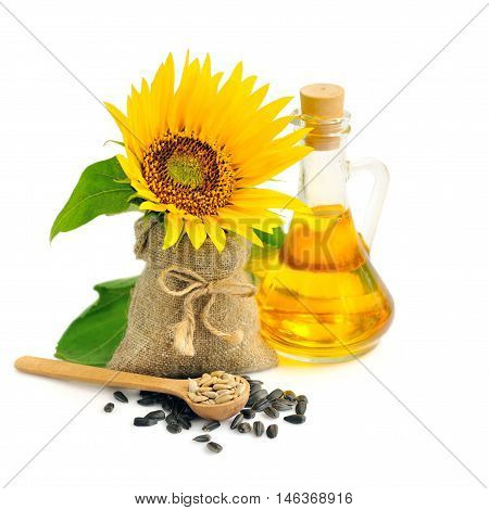 Wooden Spoon With Sunflower Seeds On A Background Of Small Bag With Flower And A Bottle Of Oil