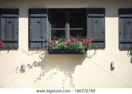 house with wooden windows with flowers. Nuremberg Bavaria Germany