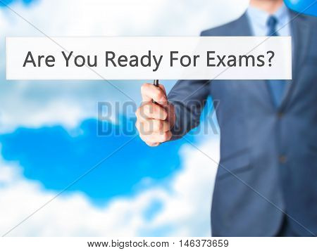 Are You Ready For Exams ? - Businessman Hand Holding Sign