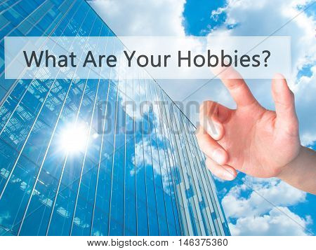 What Are Your Hobbies ? - Hand Pressing A Button On Blurred Background Concept On Visual Screen.