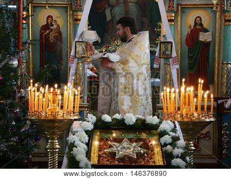 VOYUTYN UKRAINE - 08 JANUARY 2009: Orthodox priest during Christmas service