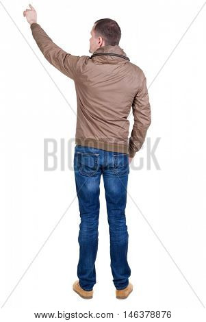 Back view of  pointing young men in  wind breaker. Young guy  gesture. Rear view people collection.  backside view of person.  Isolated over white background.