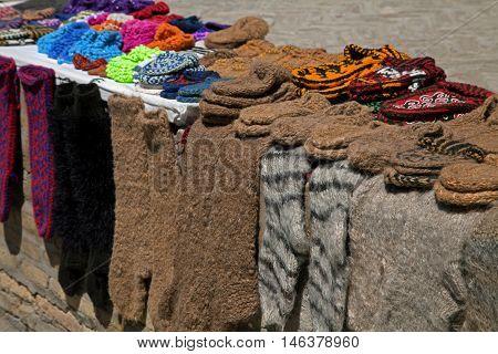 Street market with knitted socks and slippers, Khiva, Uzbekistan