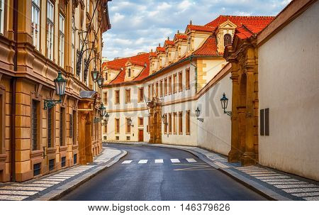 Deserted road at vintage street among old houses in town Prague. Czech Republic