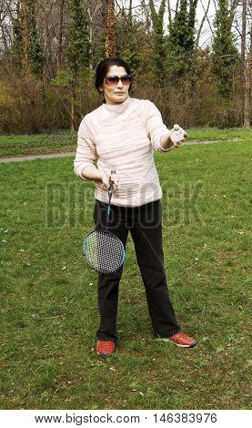 A lovely attractive sporty woman play tennis outdoors in the