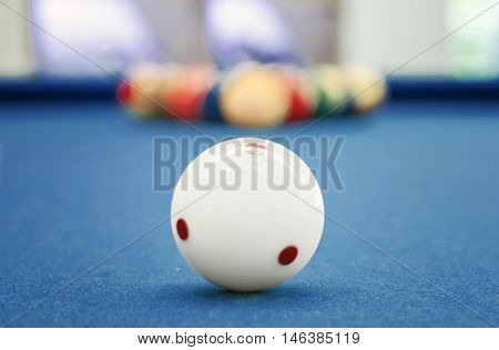 White ball on billiards table, shallow DOF