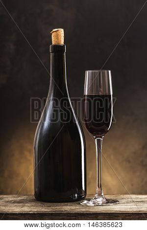 wine bottle and glass on a wooden background