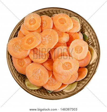 Sliced carrots in a bowl, isolated on white background