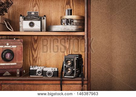 Photographer's locker with photography retro equipment. Polaroid camera medium format camera large format camera. Traditional photography. Black and white photography.