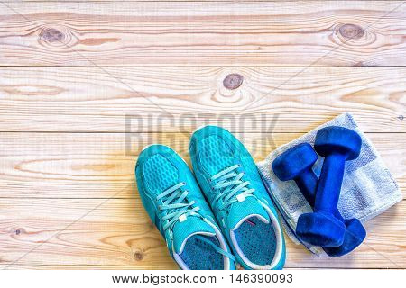 Flat Lay Shot Of Sport Equipment, Shoes On Wooden Background