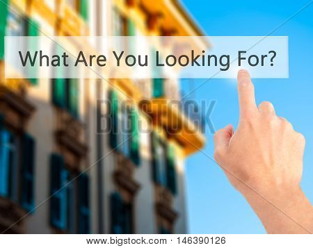 What Are You Looking For ? - Hand Pressing A Button On Blurred Background Concept On Visual Screen.