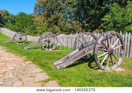 Old Cossack cannons with wooden wheels are still on duty in the ancient wooden citadel in Baturin Ukraine. Citadel of Baturin Fortress on river Seim in years 1669-1708 was residence of three Ukrainian Hetmans: Demian Mnohohrishny Ivan Samoilovych and Ivan