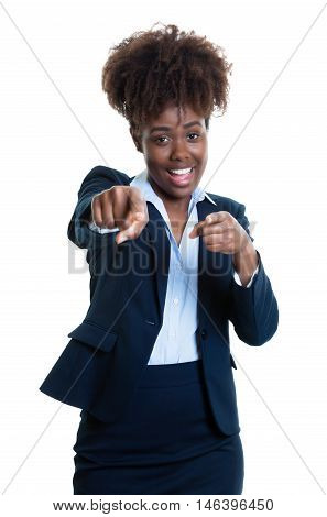African american business woman pointing at camera on an isolated white background for cut out