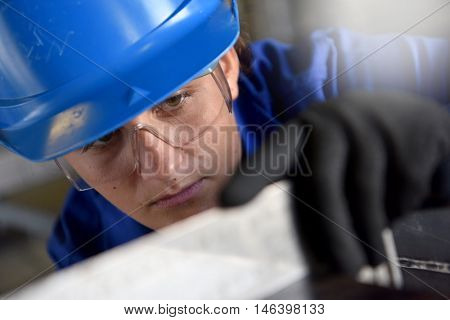 Young woman in ironworks training course