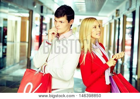 Young couple thinking over things they need to buy