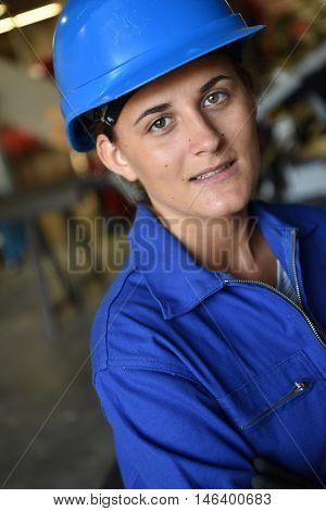Portrait of young metalwork trainee in workshop
