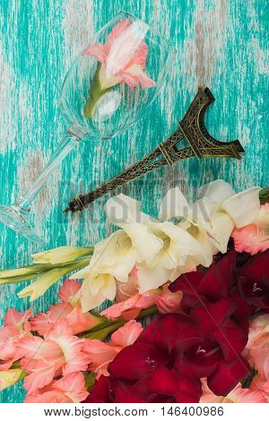 The Bouquet Of Gladiolus With Wineglass And Decorations