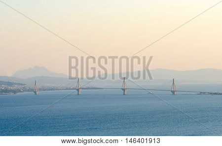 View on Rio-Antirrio bridge at sunset and deep blue water of Ionian Sea in Corinth gulf Greece
