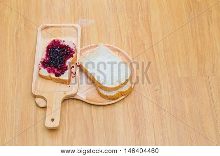 Slices Of Bread With Blackcurrant Jam For Breakfast