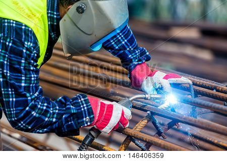 Welder Worker Welding Metal By Electrode