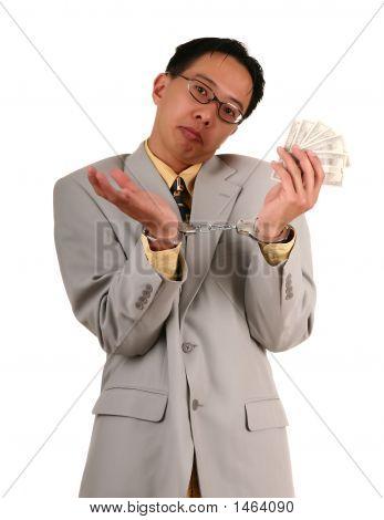 Confused Handcuffed Biz Man Holding Money