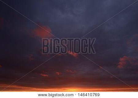 Gloomy dark blue sky in flames Sunset
