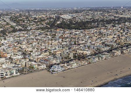 Hermosa Beach, California, USA - August 16, 2016:  Afternoon aerial view of coastal Hermosa Beach and Manhattan Beach communities in Southern California.