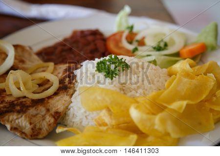 rice with chicken beans and salad from Nicaraguan cuisine