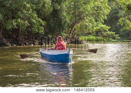 Granada Nicaragua - December 23 2015: man using a boat on river from Nicaragua