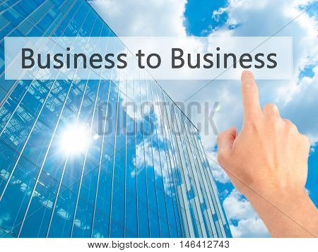 Business To Business - Hand Pressing A Button On Blurred Background Concept On Visual Screen.