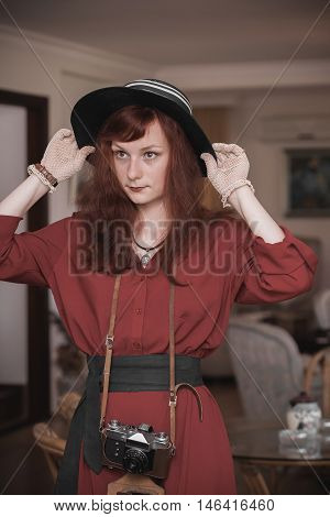 Model In A Vintage Costume With Camera
