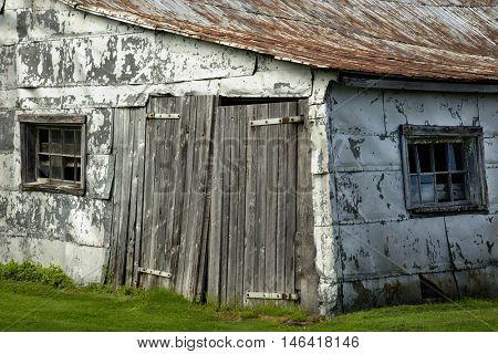 Detail of a old barn door in a field