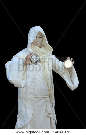 White Wizard manipulating christal balls  isolated on black background.
